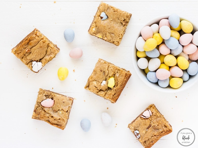 Mini egg Easter blondies with bowl of Cadbury mini eggs