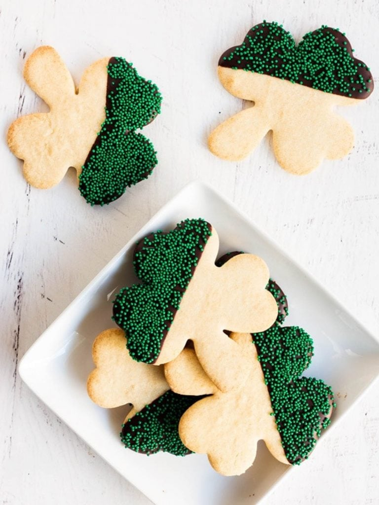 shamrock sugar cookies on square white plate