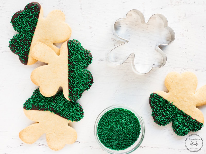 shamrock st patrick's day cookies with cookie cutter and green sprinkles
