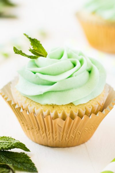 Kentucky Derby Mint Julep Cupcakes with gold cupcake liner and mint green frosting