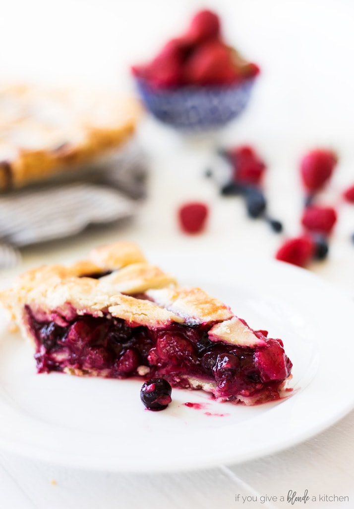 triple berry pie slice with berries and crust