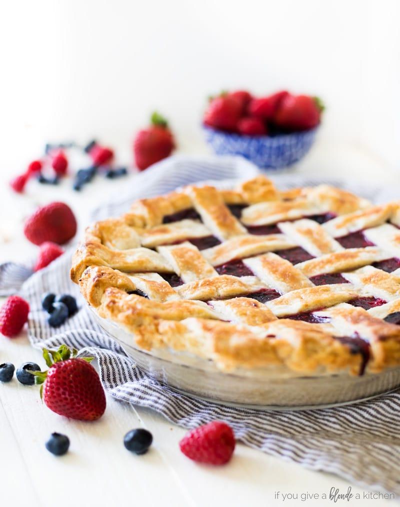 Triple berry pie lattice crust strawberries raspberries and blueberries