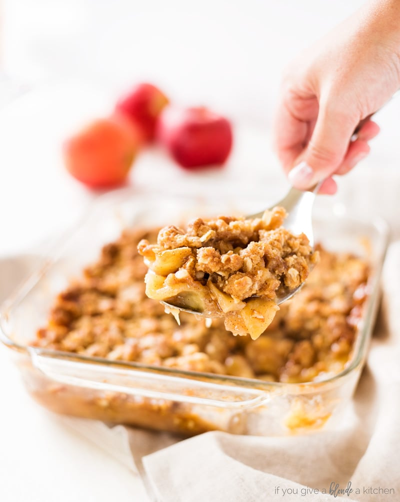 best easy apple crisp recipe serving spoon with apples and oat crumble