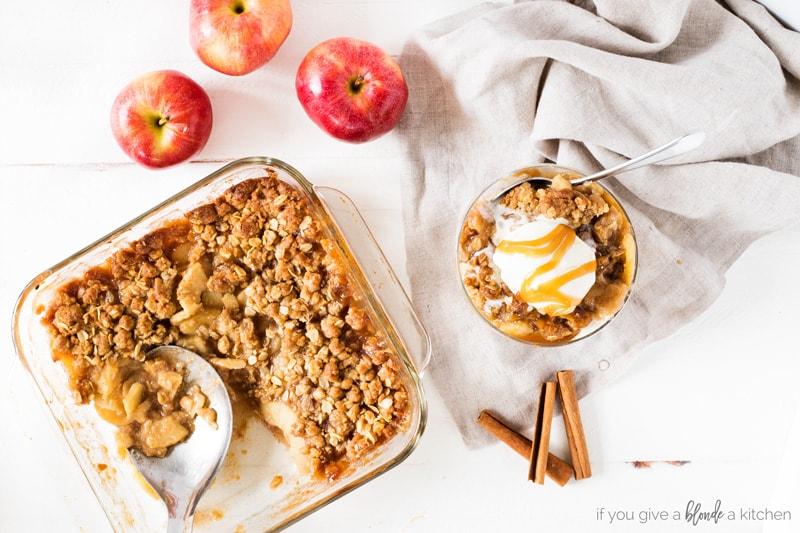 easy apple crisp recipe in 8x8 dish with apples, cinnamon sticks and ice cream