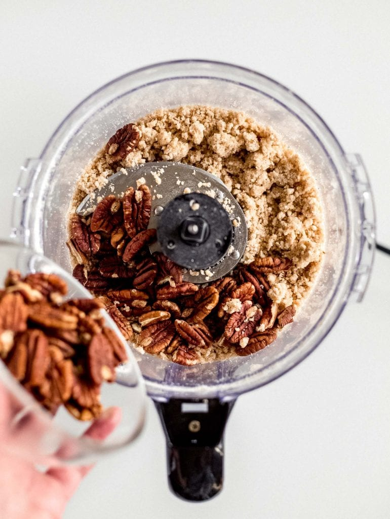 bowl of pecans poured into food processor bowl