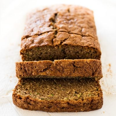 Moist zucchini bread recipe slices with cinnamon and nutmeg | www.ifyougiveablondeakitchen.com