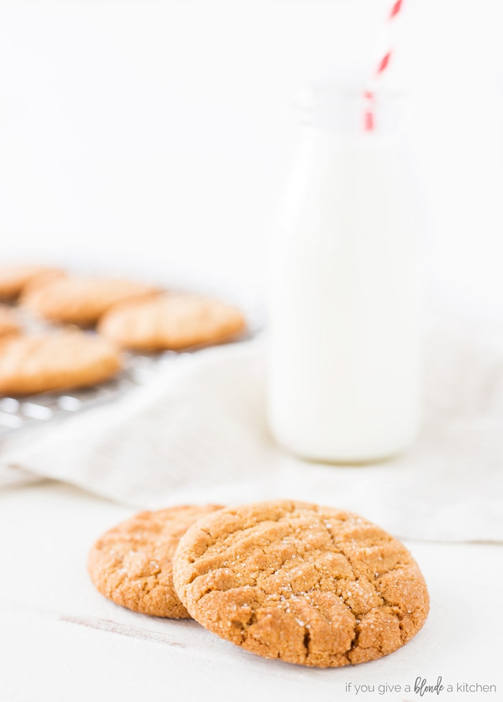 Classic peanut butter cookie recipe sugar on cookies with fork imprint and bottle of milk