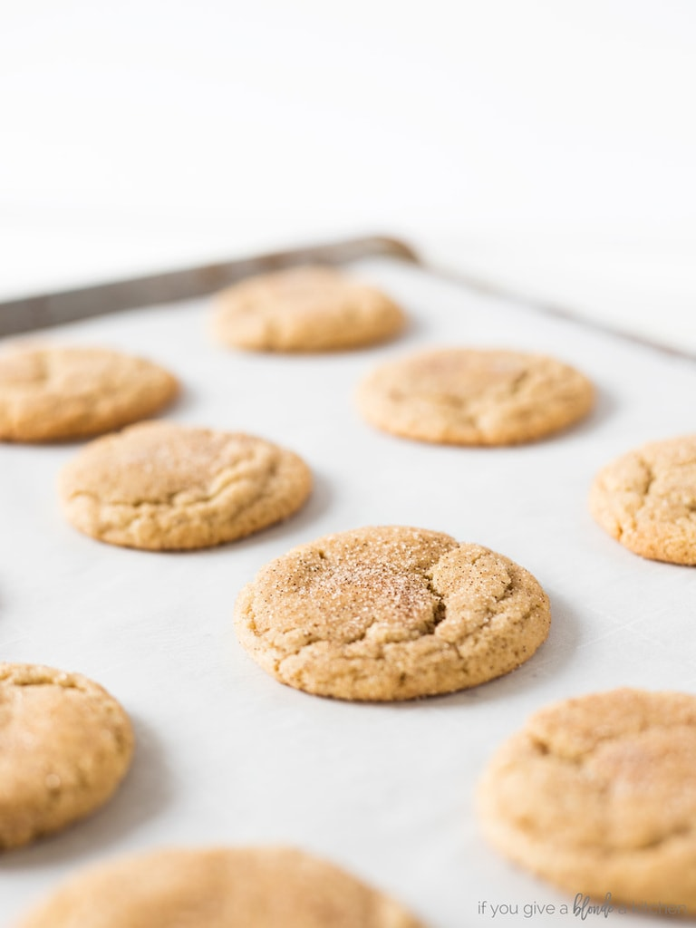 Homemade snickerdoodle cookies recipe on cookie sheet with parchment paper