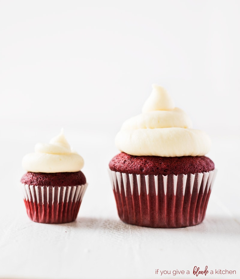 mini red velvet cupcakes and standard size next to each other