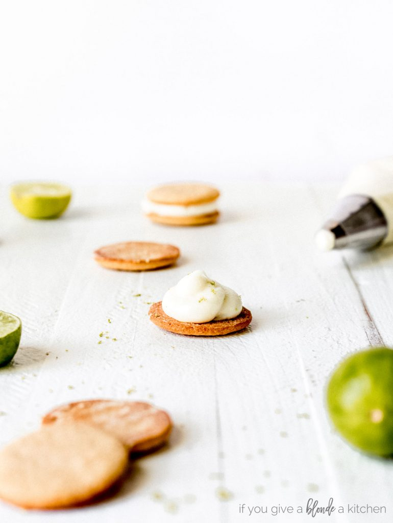 round graham cracker cookies with key lime cream cheese frosting. Cookie sandwiches
