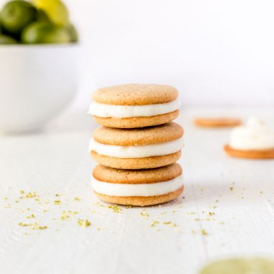 key lime pie cookies stacked on top of each other with lime in a bowl