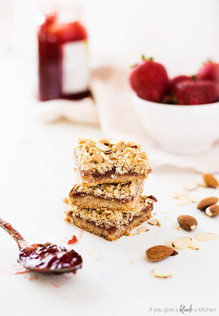 strawberry oat bars stack of three bars with almond and strawberry jam