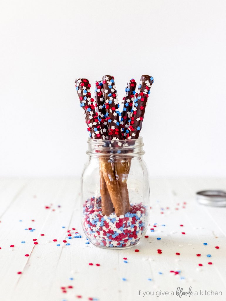 chocolate covered pretzel rods fourth of july sprinkles in mason jar