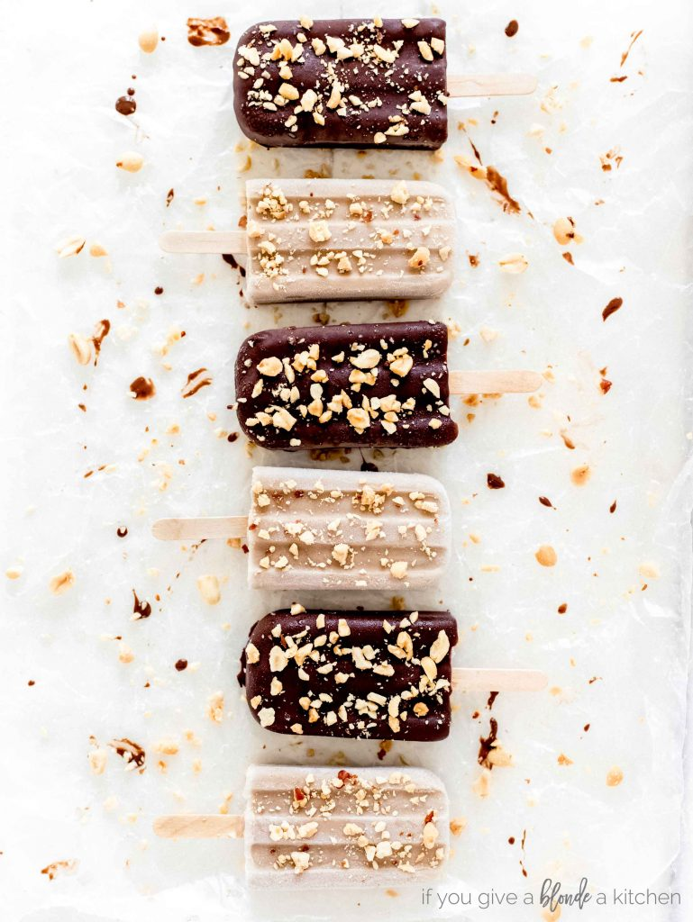 chocolate banana peanut butter popsicles alternating dipped in chocolate