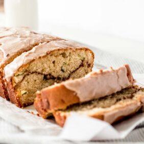 cinnamon swirl zucchini cake close up shot of cake with icing