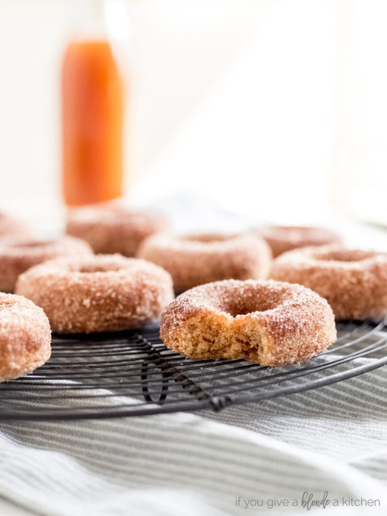 apple cider donuts on wire cooling rack