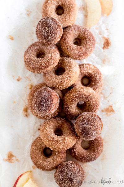pile of donuts and muffins with cinnamon sugar