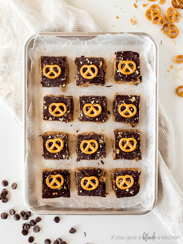 chocolate peanut butter pretzel bars cuts in squares on baking sheet