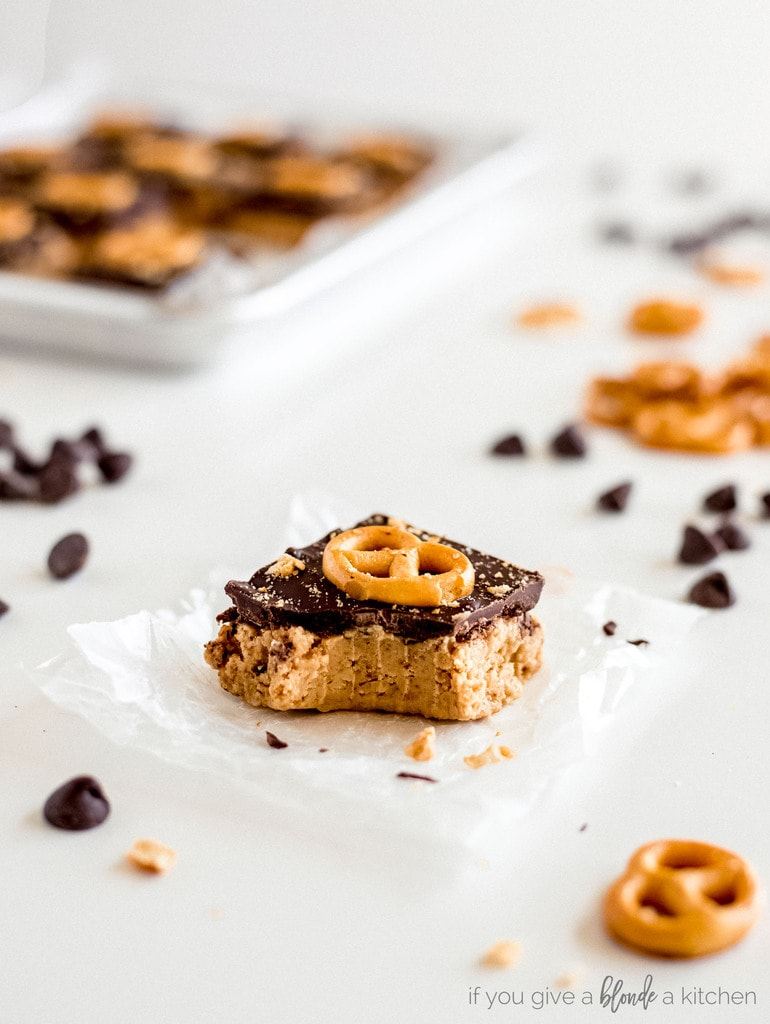 peanut butter pretzel bars with chocolate and bite