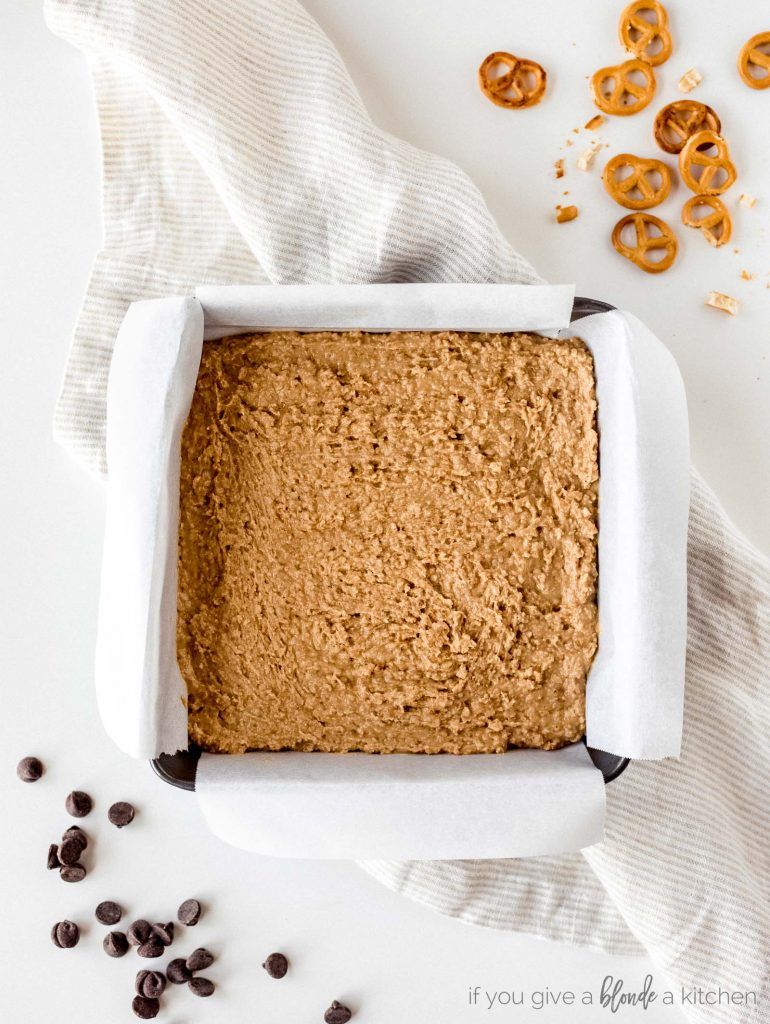 step one no bake peanut butter pretzel base in 8x8 baking pan