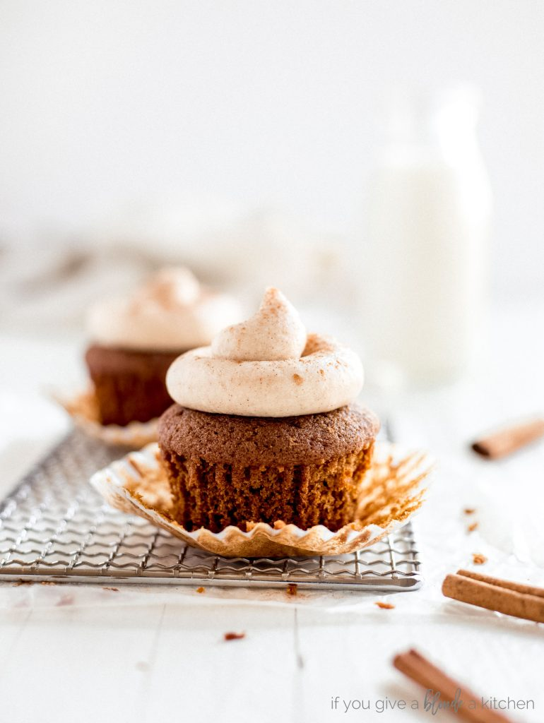 gingerbread cupcakes with paper liner unwrapped sitting on wire cooling rack