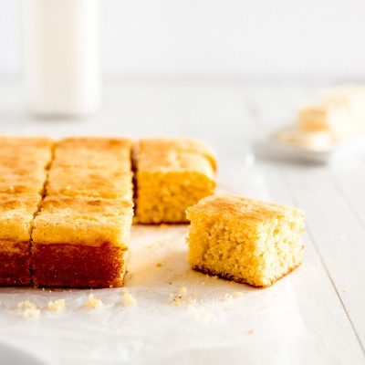 slice of cornbread on parchment paper with crumbs