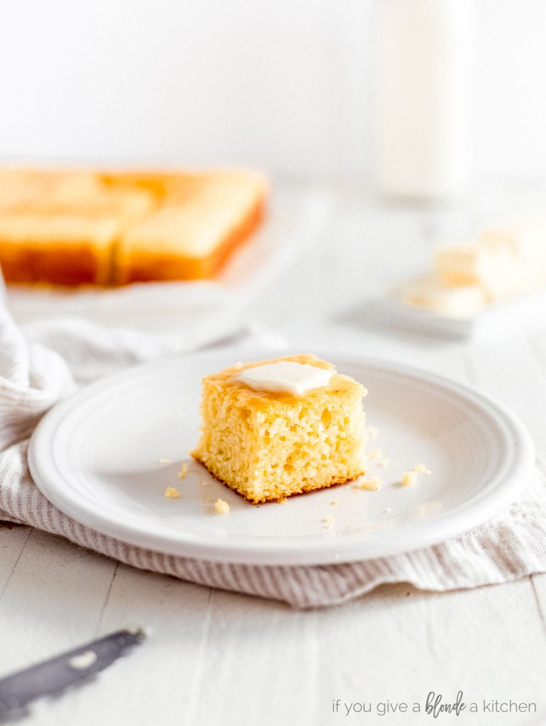 slice of cornbread with pat of butter on top