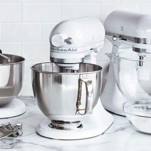 white kitchenaid stand mixer with metal bowl