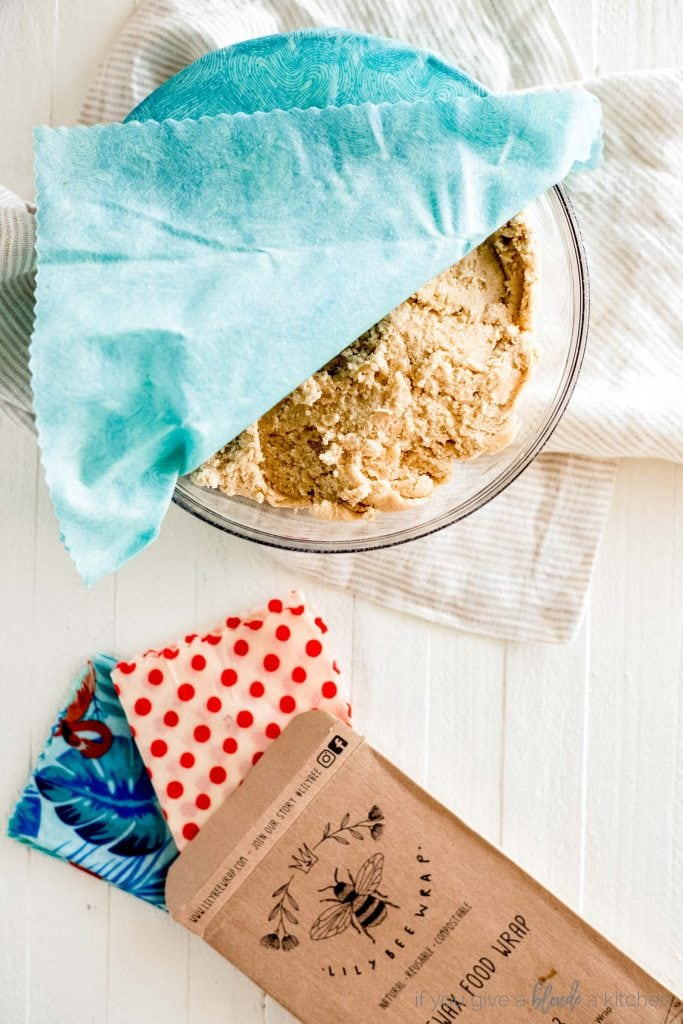 bowl of snickerdoodle cookie dough covered with blue beeswax food wrap sustainable