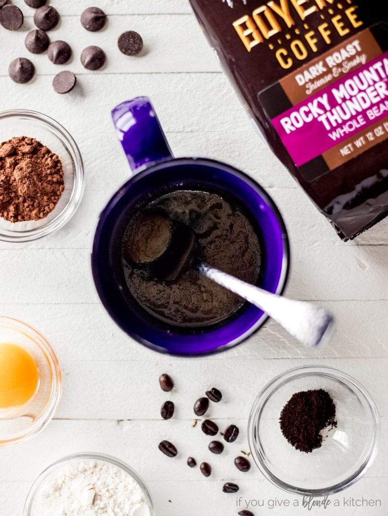blue mug with spoon and double chocolate chip cookie ingredients