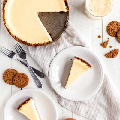 eggnog cheesecake with two slices on white plates
