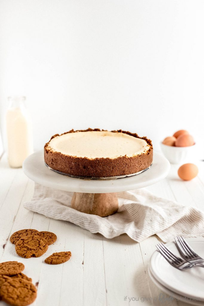 eggnog cheesecake with ginger snap crust on marble cake stand