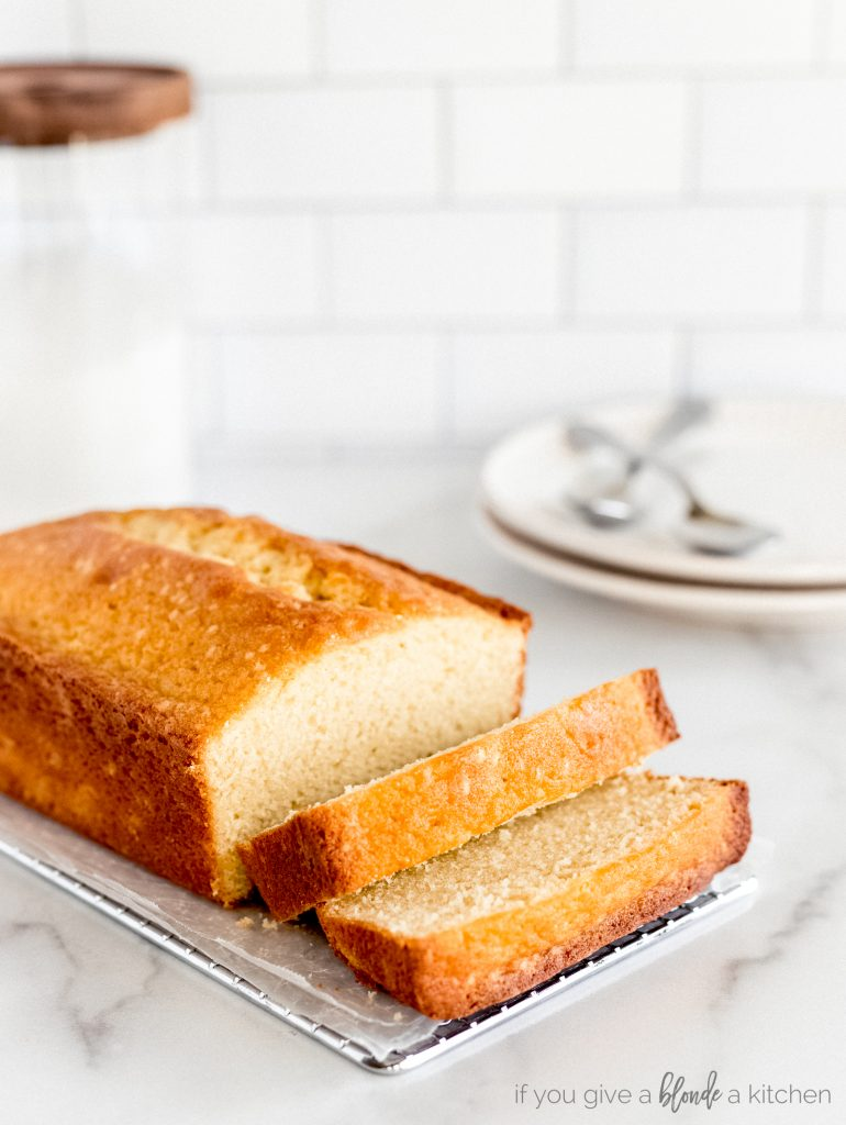 cream cheese pound cake loaf with two slices cut off