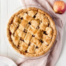 apple pie lattice crust pink towel white wood