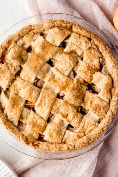 apple pie lattice crust pink towel white wood