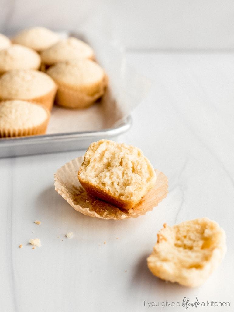 muffin broken in half on paper liner