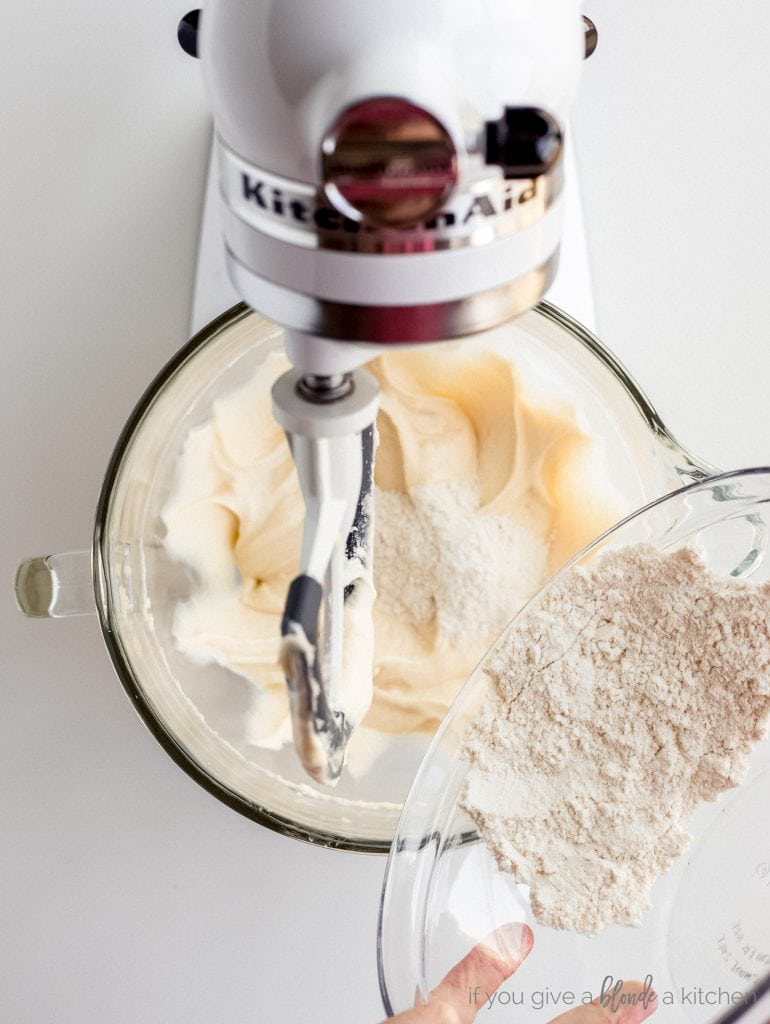 bowl of flour poured into coffee cake batter