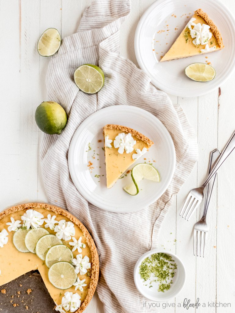 key lime pie slices on plates, pinch bowl of lime zest, lime wedges