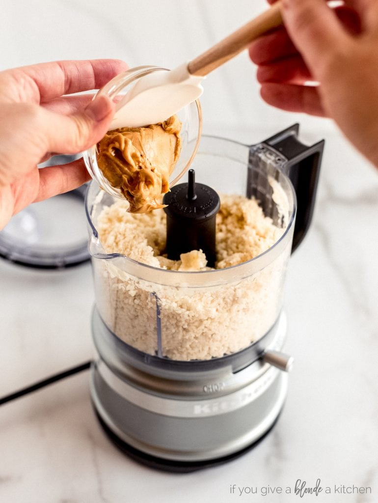peanut butter scooped into mini food processor