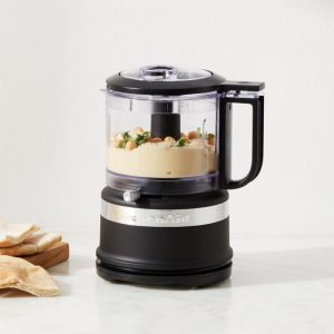 black mini food processor with hummus inside